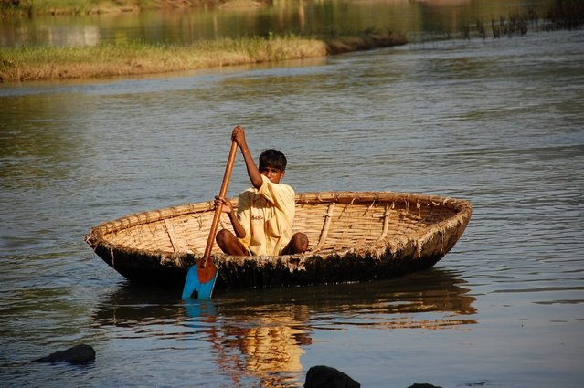 The Boatmen by Ned Marcus—image of a coracle in India.